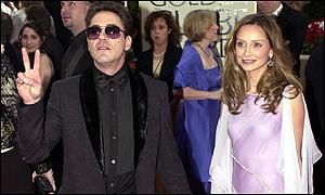 Downey Jr arrives at the awards with Calista Flockhart
