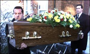 Ronnie Hills coffin is removed from his home in Holywood