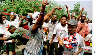 Opposition New Patriotic Party (NPP) supporters dance outside the Accra home of John Kufuor