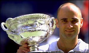 Andre Agassi with the Australian Open trophy he won in 2000