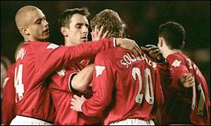 Ole Gunnar Solskjaer is congratulated after the first goal