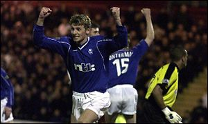 Tore Andre Flo celebrates his opening goal