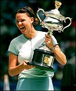 Lindsay Davenport lifts Woman's trophy