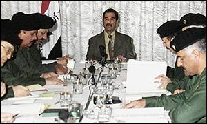 Saddam Hussein chairing a cabinet meeting