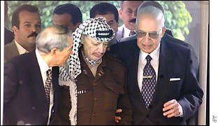 Yasser Arafat is surrounded by Esmat Abdel Meguid, Secretary General of the Arab League, right, and Egyptian adviser Osama al-Baz
