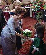 Princess Margaret is presented with a bouquet