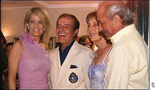 Cecilia Bolocco (left) and Carlos Menem with Menem's brother Eduardo and his wife