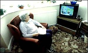 Elderly woman sitting in living room
