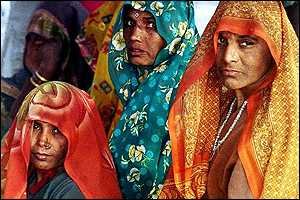 Hindu women devotees wait for accommodation in Allahabad
