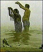 Couple bathing in the River Ganges