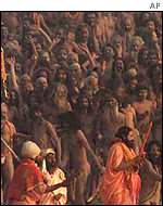 Hindu holy men prepare for a holy dip in the River Ganges