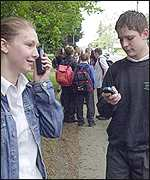 School pupils use their phones