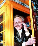 Hans Snook uses his mobile in a phone box