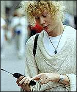 Woman using a phone in the street