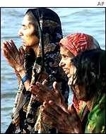 Praying on the banks of the Ganges