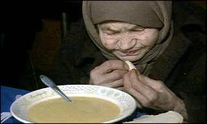 Elderly Moscow woman eating charity meal