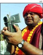 Devotee with video camera
