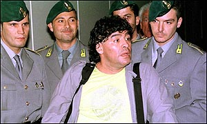 Diego Maradona is surrounded by Italian tax police