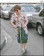 Woman on a scooter