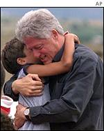 Bill Clinton with Albanian refugee