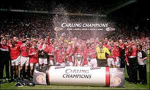 Manchester United celebrate with the Premiership trophy