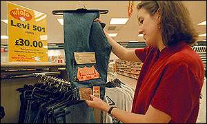 Tesco customer looks at a pair of Levi's jeans