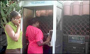 A Nigerian woman using a mobile phone in Lagos