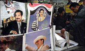 A street vendor sells posters of Saddam on the 10th anniversary of the Gulf War