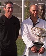 Gilbert (left) and Agassi pose for the cameras after last year's Australian Open triumph