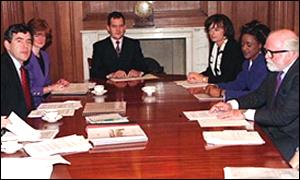 Paul Burrell at head of table