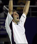 Greg Rusedski punches the air in delight after win over Gustavo Kuerten