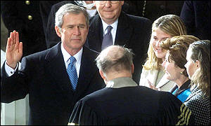 George W Bush takes the oath surrounded by his family