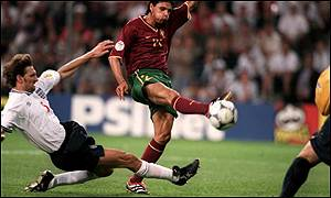 Tony Adams tackles Portugal's Nuno Gomes