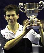 Tim Henman holds up Samsung Open trophy