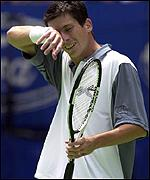 Tim Henman in action against Pat Rafter