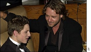 Gladiator star Russell Crowe talks to Billy Elliot star Jamie Bell after the awards ceremony
