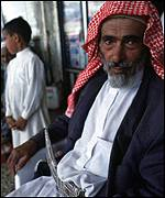 Saudi Arabia man at market stall