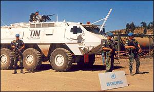 UN soldiers in front of a tank