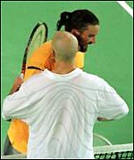 Andre Agassi (in white) Pat Rafter (in yellow)