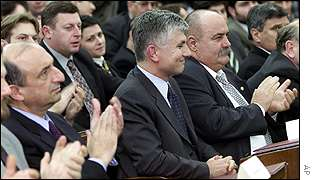 Zoran Djindjic is applauded by parliamentary colleagues