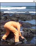 Ecuadorean technician checks water