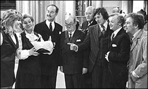 John Inman, second right, in his most familiar role