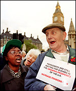 Protesting pensioner outside Parliament