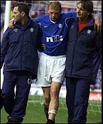 Jorg Albertz hobbles off the park