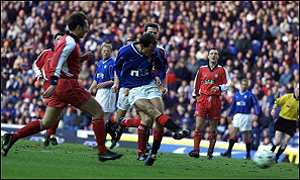 Allan Johnston slams home the opening goal at Ibrox