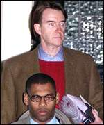 Peter Mandelson leaves his London home with his protection officer