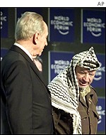 Former Israeli Prime Minister Shimon Peres and Palestinian leader Yasser Arafat