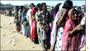 Residents of bhuji queue for food handouts
