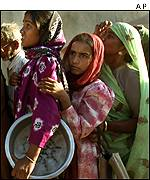 Women line up for relief aid in Bhuj
