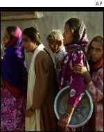 Women queue for relief in Bhuj